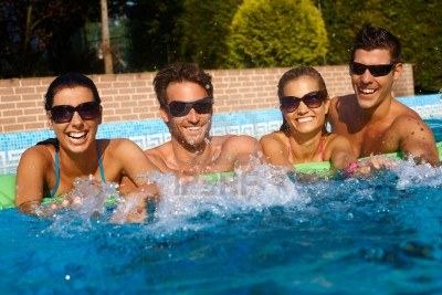 12918684-happy-friends-having-fun-in-outdoor-swimming-pool-at-summertime-laughing
